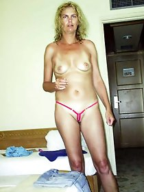 Older whore is touching herself