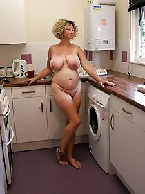 Gorgeous mature female posing undressed on camera