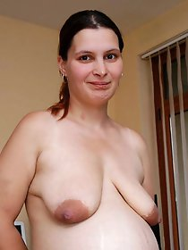 Big breasted housewives are posing totally nude