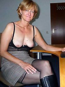 Alluring businesswoman spreading her pussy lips